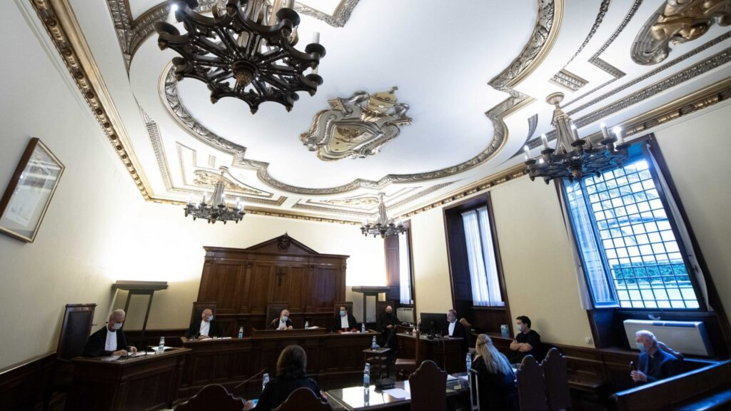 """This Oct. 14, 2020, file photo shows the Vatican City State criminal court during the opening of the trial of Father Gabriele Martinelli and Msgr. Enrico Radice. At a Vatican trial Feb. 24, former students of the St. Pius X Pre-Seminary told the court that there was an """"unhealthy"""" environment at the seminary and that they endured psychological pressure and witnessed inappropriate touching by Father Martinelli, who is accused of abusing a younger student. (CNS photo/Vatican Media)"""