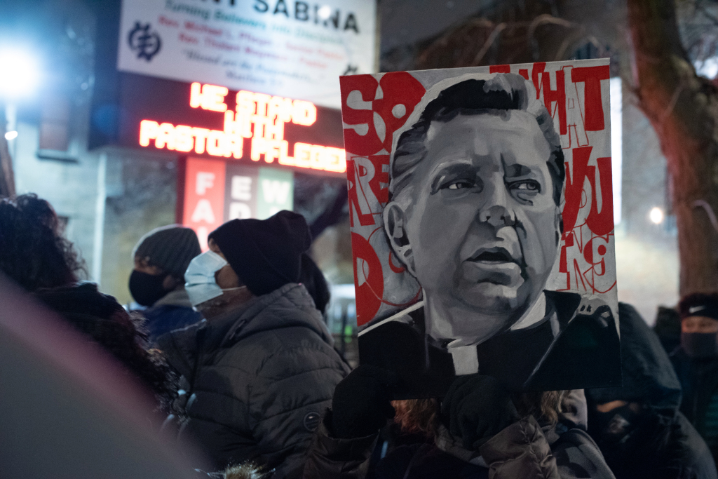 A person holds a painting of Rev. Michael Pfleger as members of the faith community rally in the Auburn Gresham neighborhood on January 8, 2021 the week Pfleger was removed from his post at Saint Sabina while a decades-old sex abuse allegation is investigated. Colin Boyle, Block Club Chicago