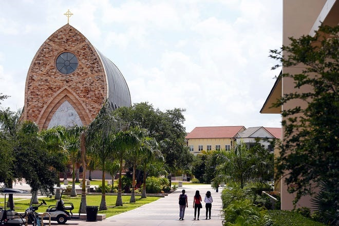 Patrons are seen on campus near the iconic Quasi Parish Ave Maria Oratory Tuesday, May 12, 2015, at Ave Maria University in Ave Maria. Corey Perrine / Naples Daily News