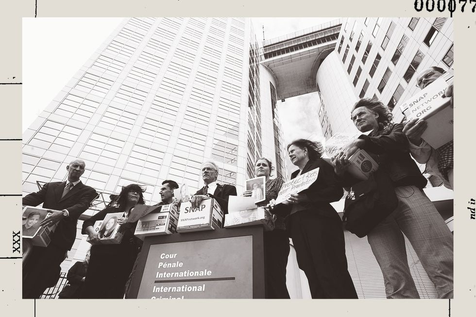 Survivors holding boxes containing documents alleging decades of systemic cover-up of sexual abuse. They are gathered in front of the International Criminal Court in The Hague.