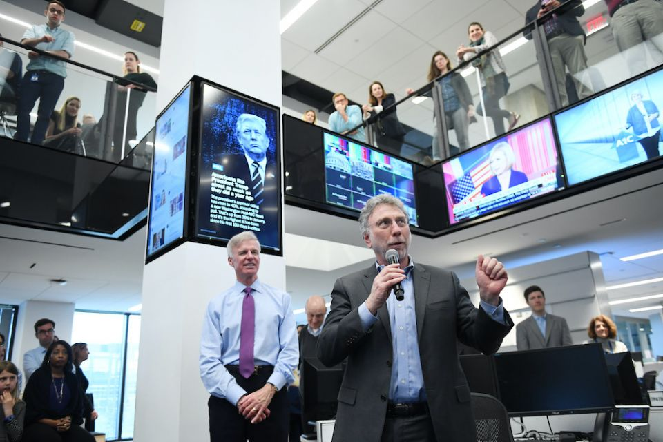 Executive Editor Martin Baron, holding microphone, speaks to staff at The Washington Post in this undated photo. (Courtesy of The Washington Post)