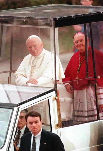 Newark Archbishop Theodore McCarrick rides in the popemobile alongside Pope John Paul II during his visit to Newark on Oct. 4, 1995. Joe McLaughlin/THN