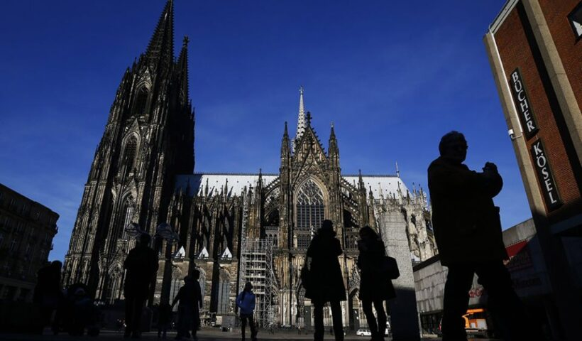 People are silhouetted against the Cologne Cathedral in Germany in 2016. (CNS/Reuters/Wolfgang Rattay)