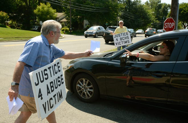 Protesters distribute leaflets in 2015 criticizing Bergen Catholic's handling of sex abuse allegations against Bothers Charles B. Irwin and John Chaney. Viorel Florescu / NorthJersey.com