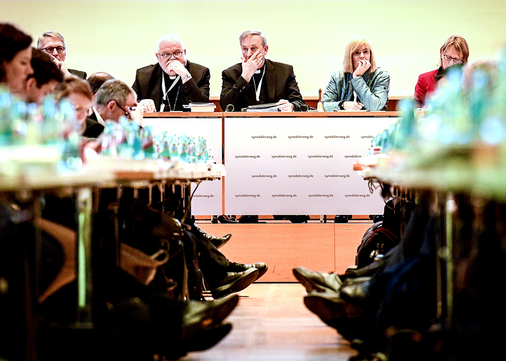 Lay leaders and bishops are seen Jan. 31, 2020, during the synodal assembly in Frankfurt, Germany. Pictured at the front table, from left, are Thomas Sternberg, president of the Central Committee of German Catholics; Cardinal Reinhard Marx of Munich and Freising, president of the German bishops' conference; Auxiliary Bishop Wilfried Theising of Munster; Claudia Nothelle, member of the central committee; and Karin Kortmann, vice president of the central committee. (Photo: CNS / Harald Oppitz, KNA)