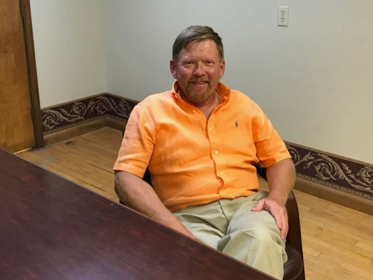The Rev. Dennis H. Kucharczyk inside the downtown Bay City law office of attorney Matthew L. Reyes on the afternoon of July 24, 2019.