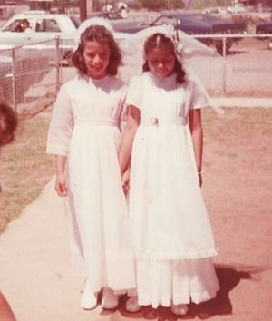 """Diana Almader-Douglas and """"Jane Doe"""" stand outside of St. Bernard Catholic Church in Pirtleville, Arizona, at their first communion. Almader-Douglas came forward in 2019 and said she was sexually abused by Father Charles Knapp, a full-time retired priest with the Diocese of Tucson. -- Forester Haynie"""