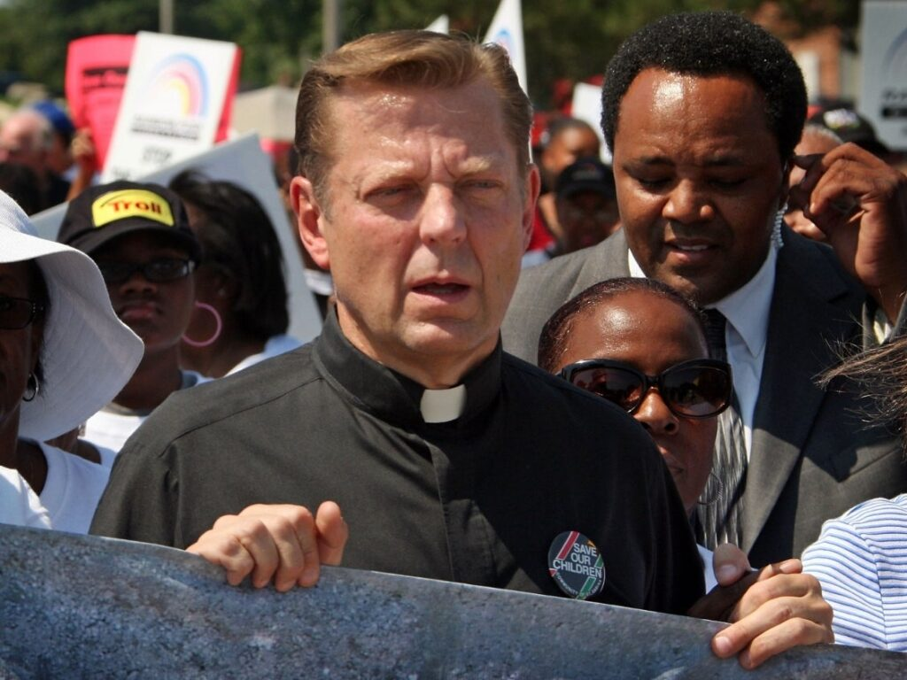 Two men who say St. Sabina's activist priest, the Rev. Michael Pfleger, of sexual abuse in the 1970s have taken lie-detector tests in hopes of strengthening their accusations. (Scott Olson/Getty Images)