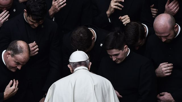 Pope Francis prays with priests at the end of a limited public audience at the San Damaso courtyard in The Vatican - Credit: AFP via Getty Images