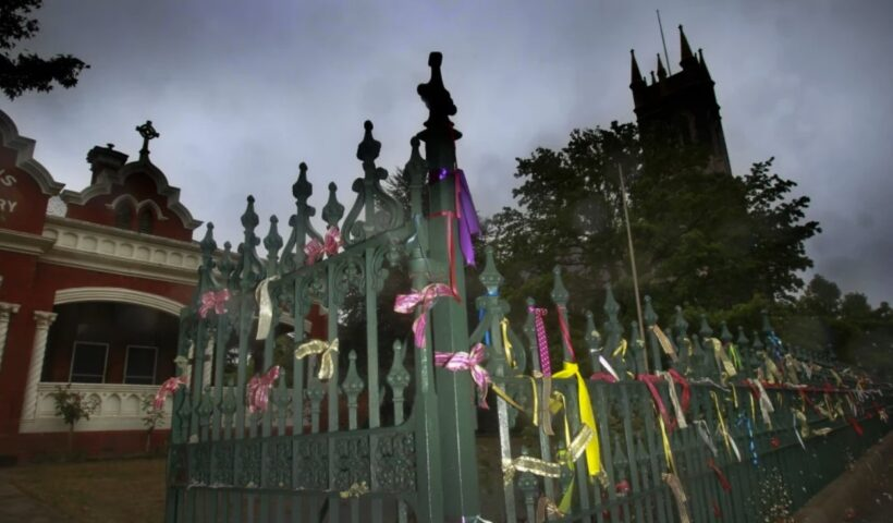 Ribbons tied to the fence at St Alipius Presbytery, church and old boys school in Ballarat pay tribute to the victims and survivors of child abuse. Photo Simon O'Dwyer