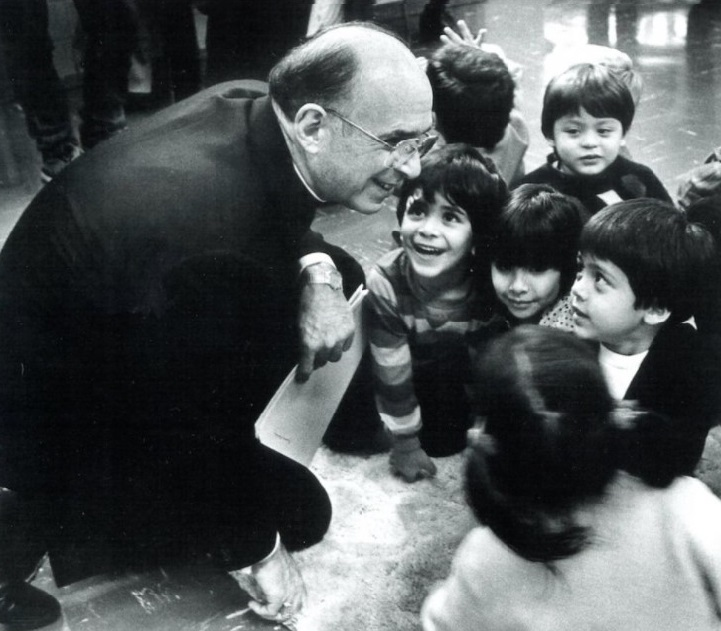 The late Chicago Cardinal Joseph Bernardin is pictured with children in an undated photo. Over a two-year period, in 1991 and 1992, the cardinal developed a comprehensive plan to address clergy sexual abuse and shared the plan with his fellow bishops, Cardinal Blase Cupich, Chicago's current cardinal-archbishop, said in an April 9, 2021, address for an international symposium on clergy sex abuse. (CNS / Courtesy of John H. White)