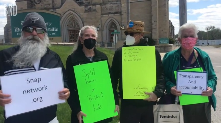 Screen shot from video: Demonstrators in Belleville including Lena Woltering and David Clohessy.