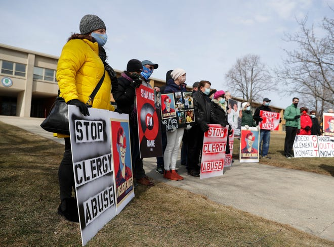 Family, friends and supporters of Nate Lindstrom, who died by suicide at age 45 after reporting he was sexually abused by priests as a child, participate in a memorial rally held outside Notre Dame Academy in Green Bay on March 7. Photo Sarah Kloepping / USA Today Network-Wisconsin