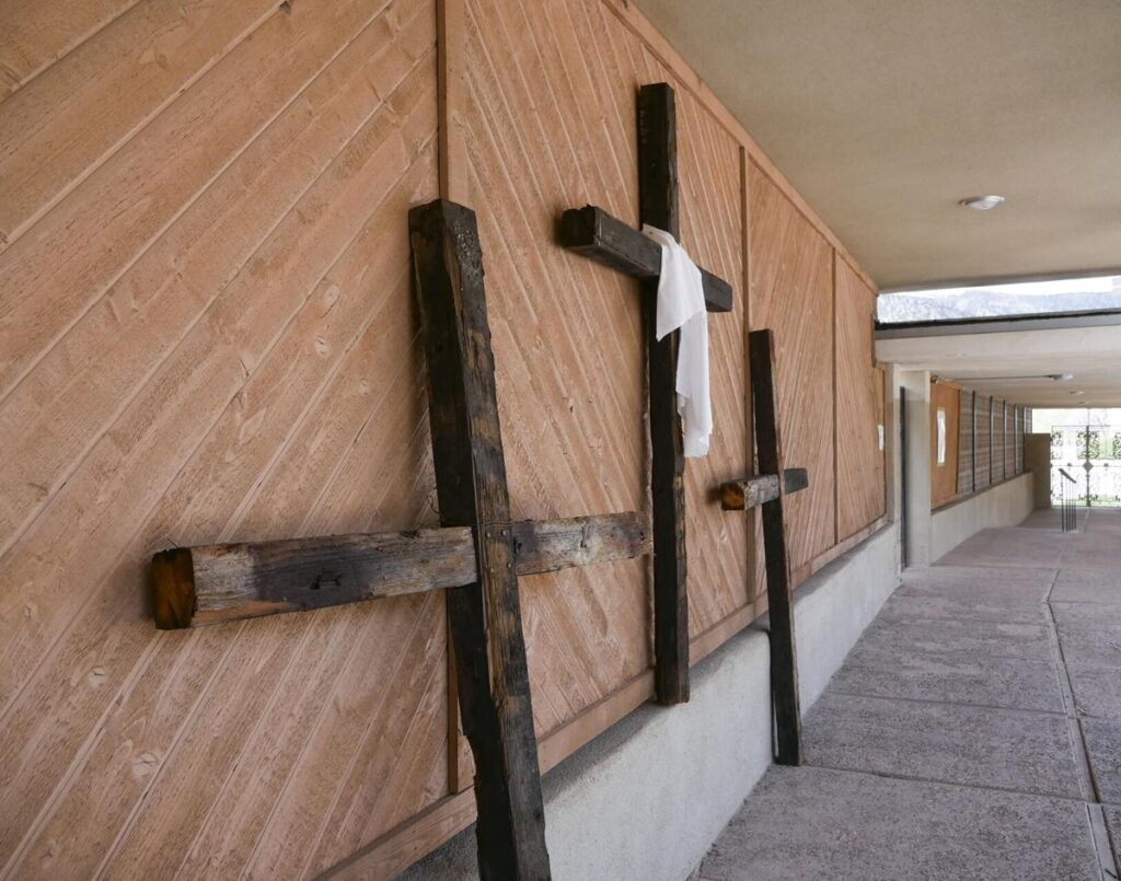 Three crosses are displayed along a walkway at Mary, Mother of Priests Catholic Church in Jemez Springs. Matt Dahlseid / The New Mexican