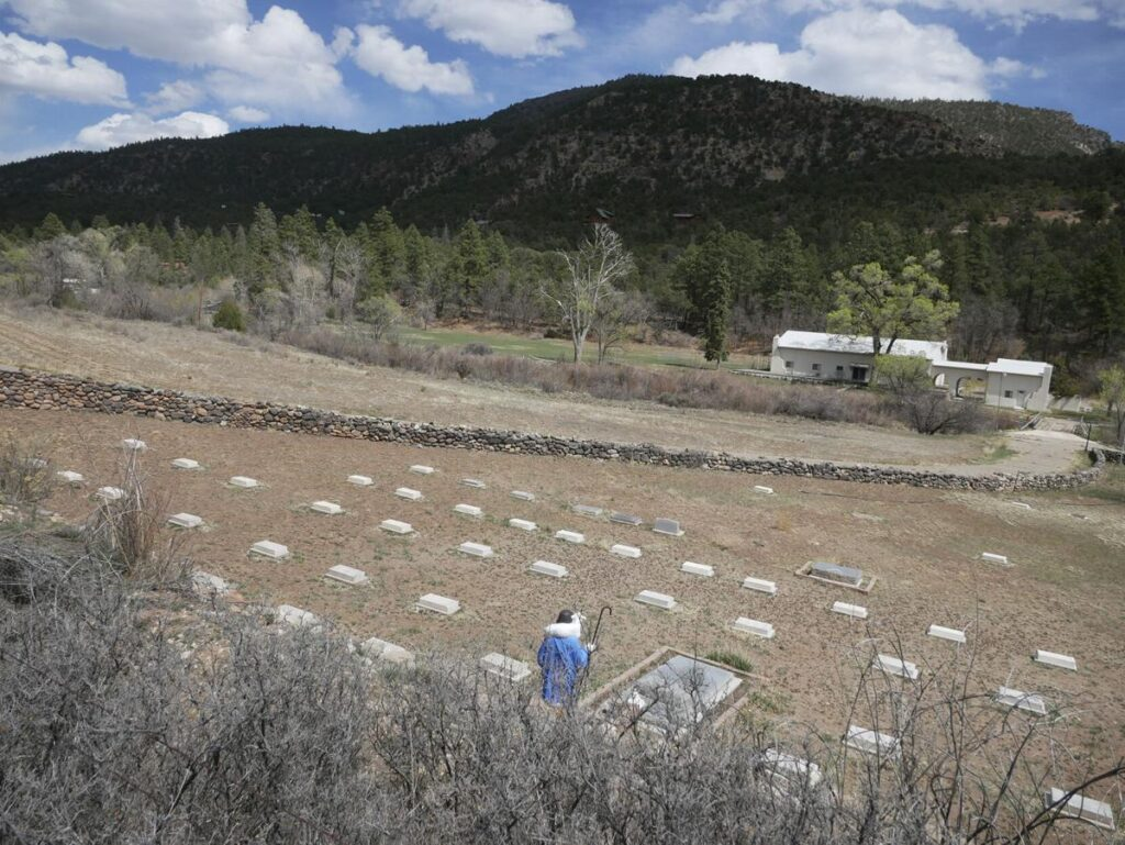 Headstones mark where priests are buried in a field on the Servants of the Paraclete's Lourdes Retreat just north of Jemez Springs. Matt Dahlseid / The New Mexican