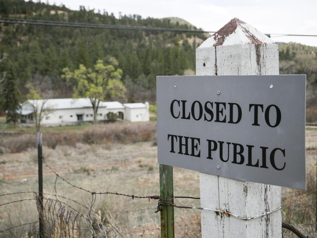 A sign deters entry to the Servants of the Paraclete's Lourdes Retreat just north of Jemez Springs. Matt Dahlseid / The New Mexican