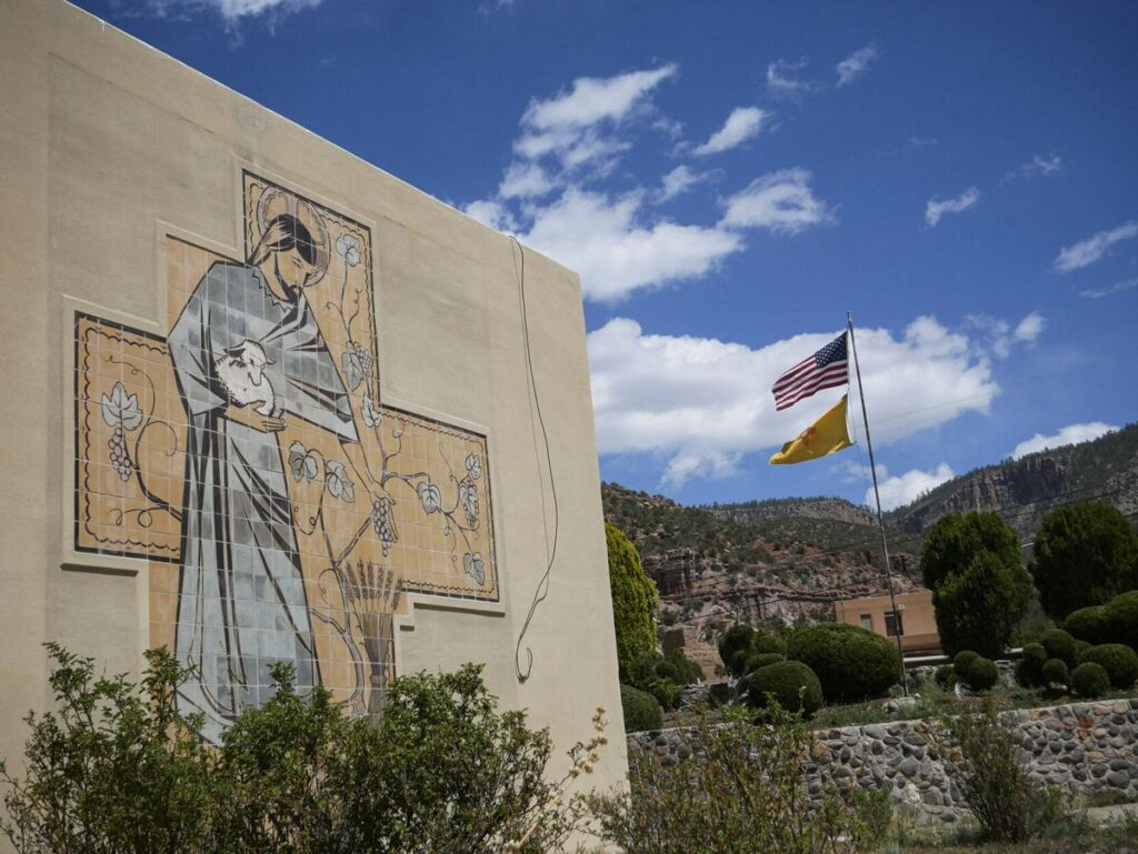 A mural on a wall of the complex around Mary, Mother of Priests Catholic Church in Jemez Springs. Matt Dahlseid / The New Mexican