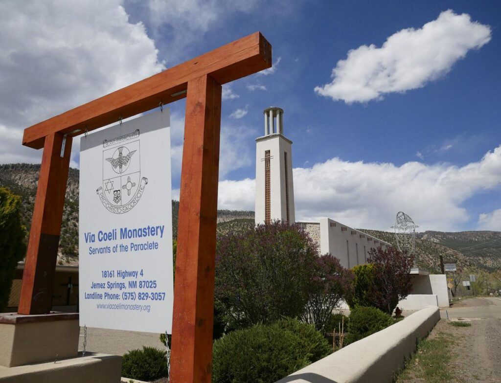 A sign for the Via Coeli Monastery hangs in front of Mary, Mother of Priests Catholic Church in Jemez Springs. Matt Dahlseid / The New Mexican