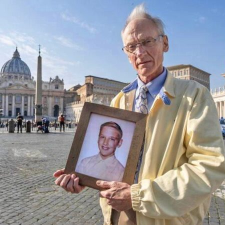 Phil Saviano in St Peter's Square during the sexual abuse summit in late February 2019; he holds a photograph of himself at age 12, when he was being assaulted by Fr David Holley; photographer unknown.
