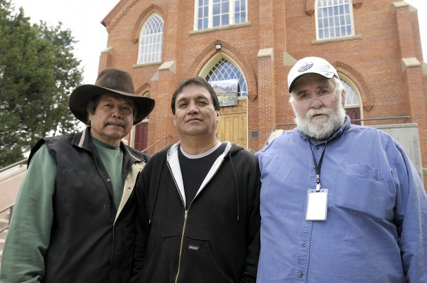 Leland Hewankorn, Francis Burke and Garry Salois stand outside St Ignatius Mission. They're among some 500 people who recently reached a settlement with the Oregon Province of the Society of Jesus for reported abuse, but they say what they really want is an apology. Photo by Tom Bauer / Missoulian