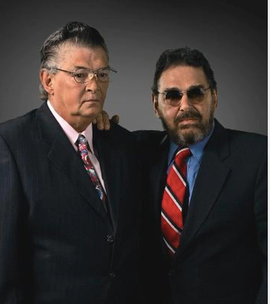 Author Charles A. Carroll, right, hired a private investigator in 2005 to find his brother, Robert L. Carroll, after a long period of separation. This photo was taken in 2006, after the brothers reunited and Chuck saw to it his disabled brother had cataract surgery, dentures and new clothes. Bobby had been homeless and working as a custodian.