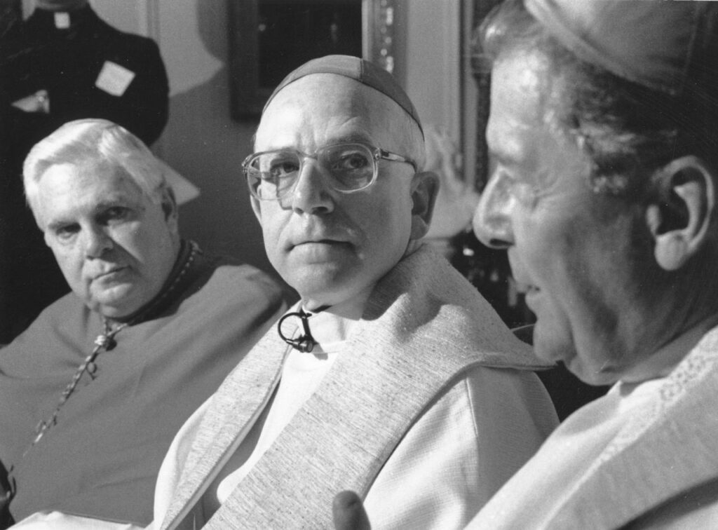 In this May 31, 1990 file photo from right, the Most Rev. Joseph F. Maguire, bishop of the Roman Catholic Diocese of Springfield, is shown with the Most Rev. Thomas L. Dupre, who was ordained that day as auxiliary bishop, and Cardinal Bernard Law. A 2009 civil suit against Maguire and Dupre alleged they knowingly allowed a priest with a history of child molestation to remain in the ministry. Law resigned in 2002 amid allegations of covering up sexual abuse in the archdiocese. Two years later, Dupre was indicted on child rape charges and removed from the ministry.