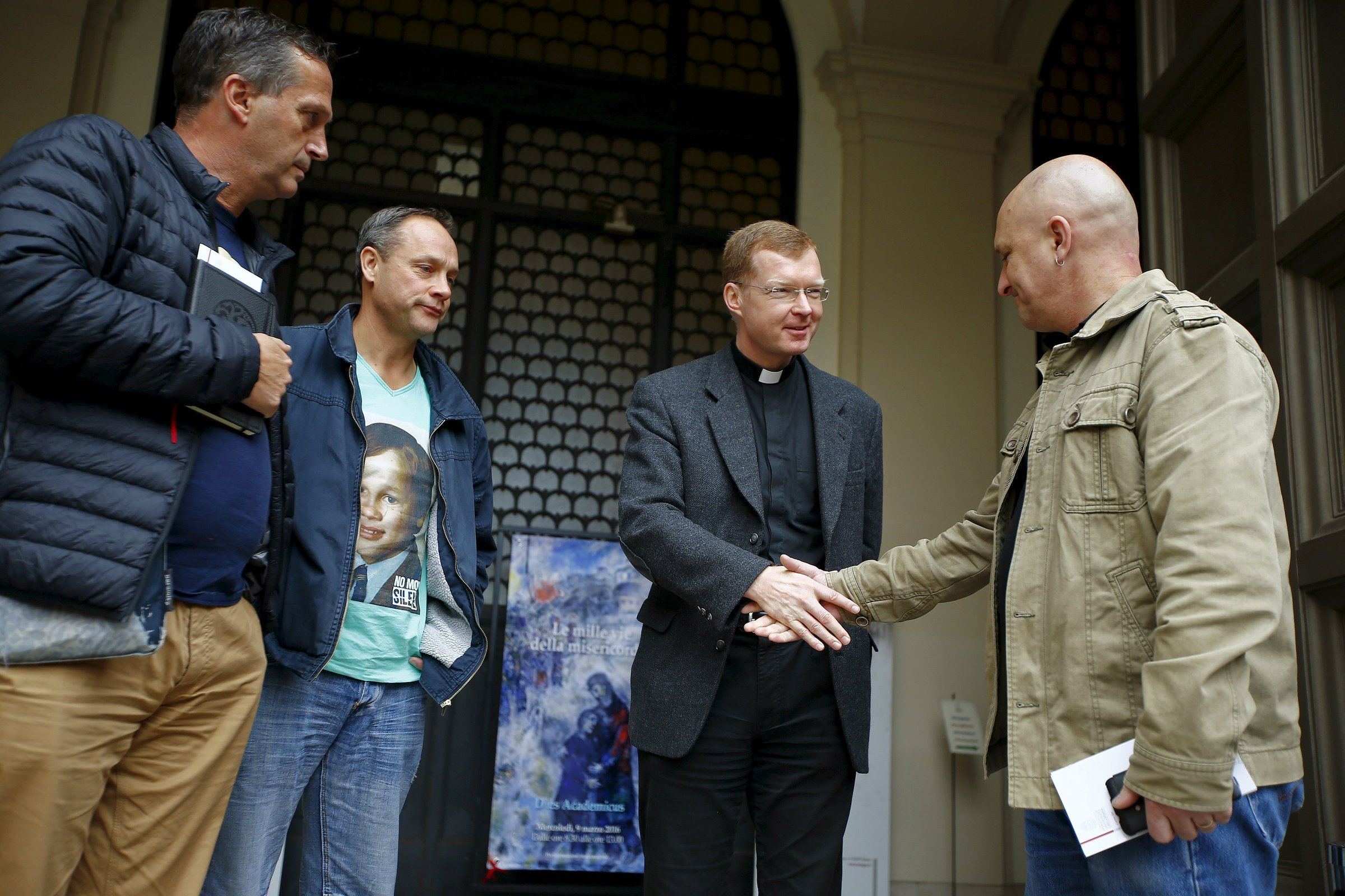 Jesuit Father Hans Zollner, a leading Vatican official dealing with clergy sexual abuse in the church, is pictured in a file photo greeting Andrew Collins, David Ridsdale and Peter Blenkiron at the Pontifical Gregorian University in Rome. The three men said they were child sex abuse victims in Australia. (Credit: Tony Gentile / Reuters via CNS.)