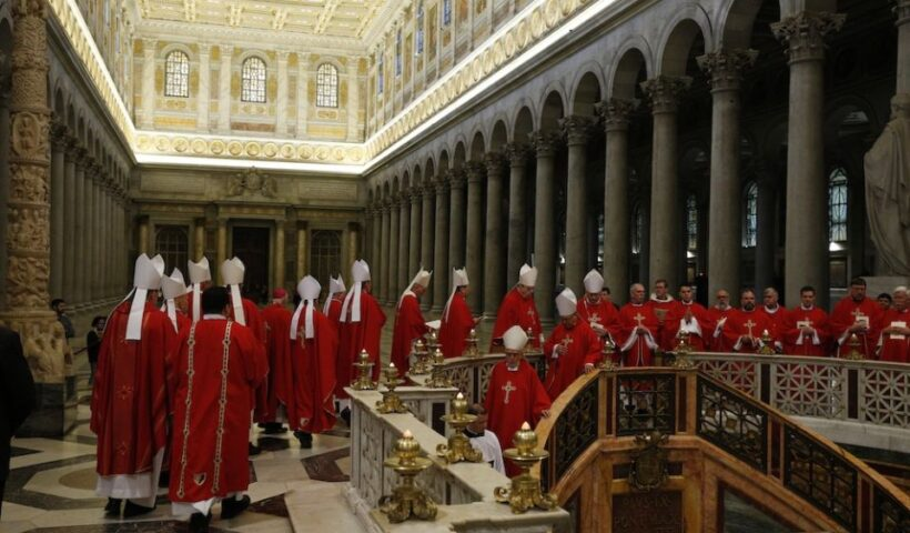 """Bishops from Arizona, Colorado, New Mexico, Utah and Wyoming walk in procession to pray at the tomb of St. Paul after concelebrating Mass at the Basilica of St. Paul Outside the Walls in Rome Feb. 12, 2020, during their """"ad limina"""" visits to the Vatican to report on the status of their dioceses. (CNS/Paul Haring)"""