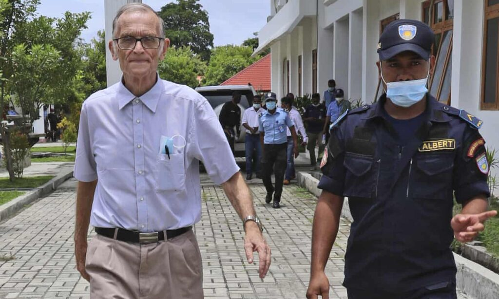A police officer escorts Richard Daschbach into court in Oecusse, Timor-Leste, in February. The former Catholic priest faces 14 counts of child sexual abuse. Photograph: Raimundos Oki / AP