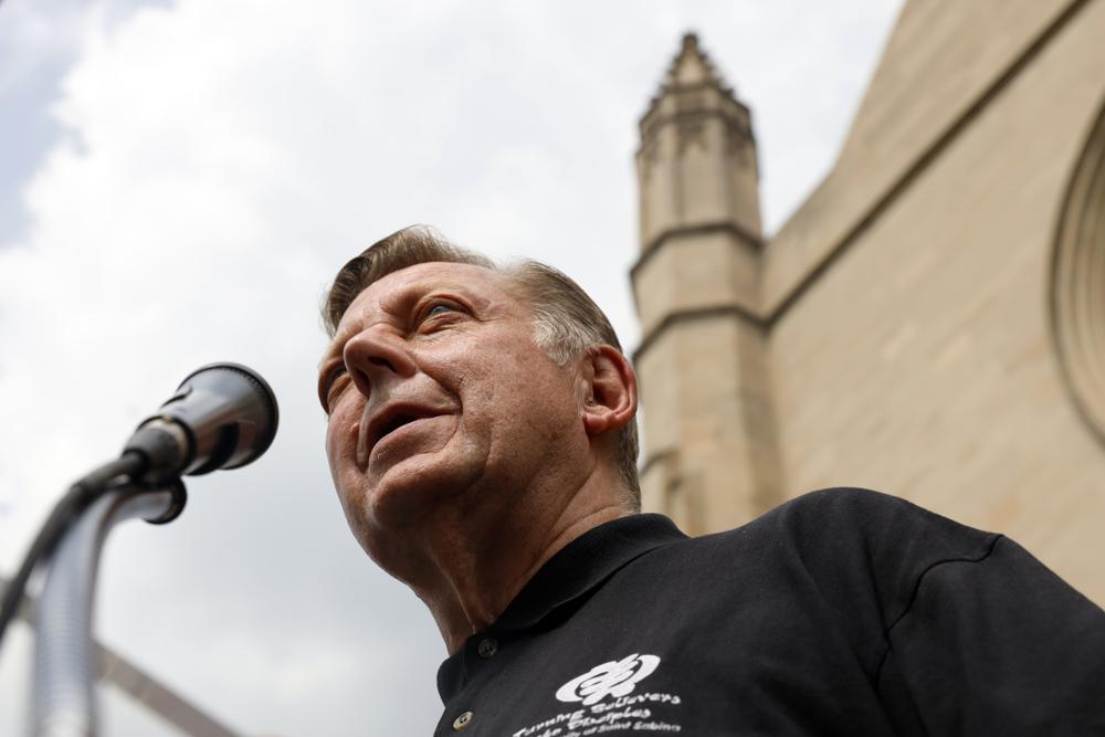 Father Michael Pfleger speaks for first time during a press conference after his reinstatement as the senior pastor at St. Sabina Church by Archdiocese of Chicago, Monday, May 24, 2021 at St. Sabina Catholic Church in the Auburn Gresham neighborhood in Chicago. (AP Photo/Shafkat Anowar)  Parishioners of St. Sabina Catholic Church cheers as Father Michael Pfleger speaks for first time during a press conference after his reinstatement as the senior pastor at St. Sabina Church by Archdiocese of Chicago, Monday, May 24, 2021, at St. Sabina Catholic Church in the Auburn Gresham neighborhood in Chicago. (AP Photo/Shafkat Anowar)  Parishioners of St. Sabina Catholic Church cheers as Father Michael Pfleger speaks for first time during a press conference after his reinstatement as the senior pastor at St. Sabina Church by Archdiocese of Chicago, Monday, May 24, 2021, at St. Sabina Catholic Church in the Auburn Gresham neighborhood in Chicago. (AP Photo/Shafkat Anowar)  Father Michael Pfleger stands among supporters before a news conference outside St. Sabina Church, after the Archdiocese of Chicago announced that Pfleger will return to his role at senior pastor at at the Auburn Gresham church, Monday afternoon, May 24, 2021. The archdiocese cleared him to return after an internal probe into decades-old allegations of sexual abuse against minors. (Ashlee Rezin Garcia/Chicago Sun-Times via AP)  Father Michael Pfleger embraces Jordan-Amman Isiah West-Williams, 9, who was baptized by Father Pfleger, following his reinstatement by Archdiocese of Chicago, Monday, May 24, 2021, in front of St. Sabina Catholic Church in the Auburn Gresham neighborhood in Chicago. (AP Photo/Shafkat Anowar)