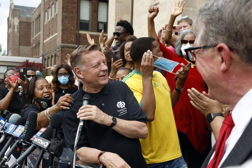 Parishioners of St. Sabina Catholic Church cheers as Father Michael Pfleger speaks for first time during a press conference after his reinstatement as the senior pastor at St. Sabina Church by Archdiocese of Chicago, Monday, May 24, 2021, at St. Sabina Catholic Church in the Auburn Gresham neighborhood in Chicago. (AP Photo/Shafkat Anowar)