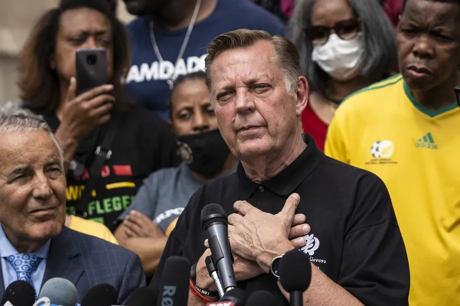 Rev. Michael Pfleger speaks Monday outside his St. Sabina Church after it was announced that he will return to his role as senior pastor after being cleared of sexual abuse allegations. Ashlee Rezin Garcia/Sun-Times