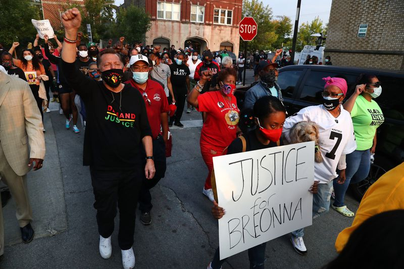 By CHRIS SWEDA / CHICAGO TRIBUNE The Rev. Michael Pfleger of St. Sabina Church leads people from Racine Avenue and 79th Street, where they shut down the intersection during rush hour in protest following the announcement of charges in the Breonna Taylor case on Sept. 23, 2020. (Chris Sweda / Chicago Tribune)