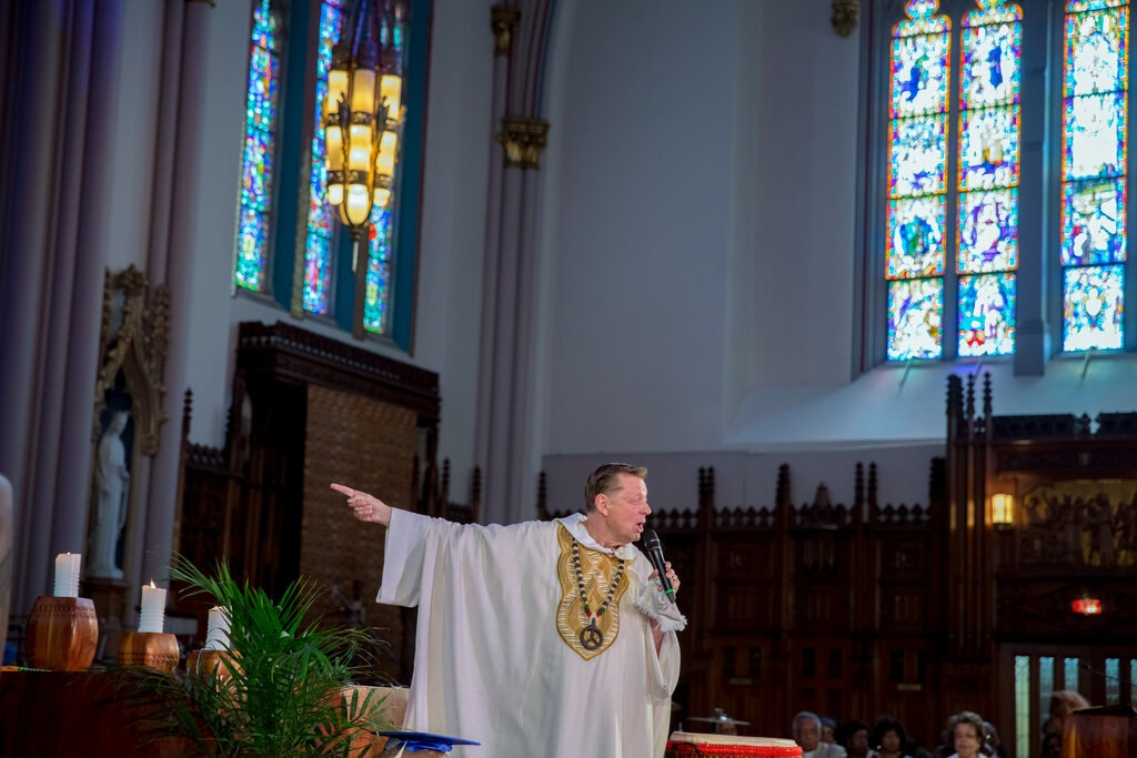 The Rev. Michael Pfleger delivering a sermon in 2016 at St. Sabina in Chicago. He is being reinstated to the parish next month.Credit...Whitney Curtis for The New York Times