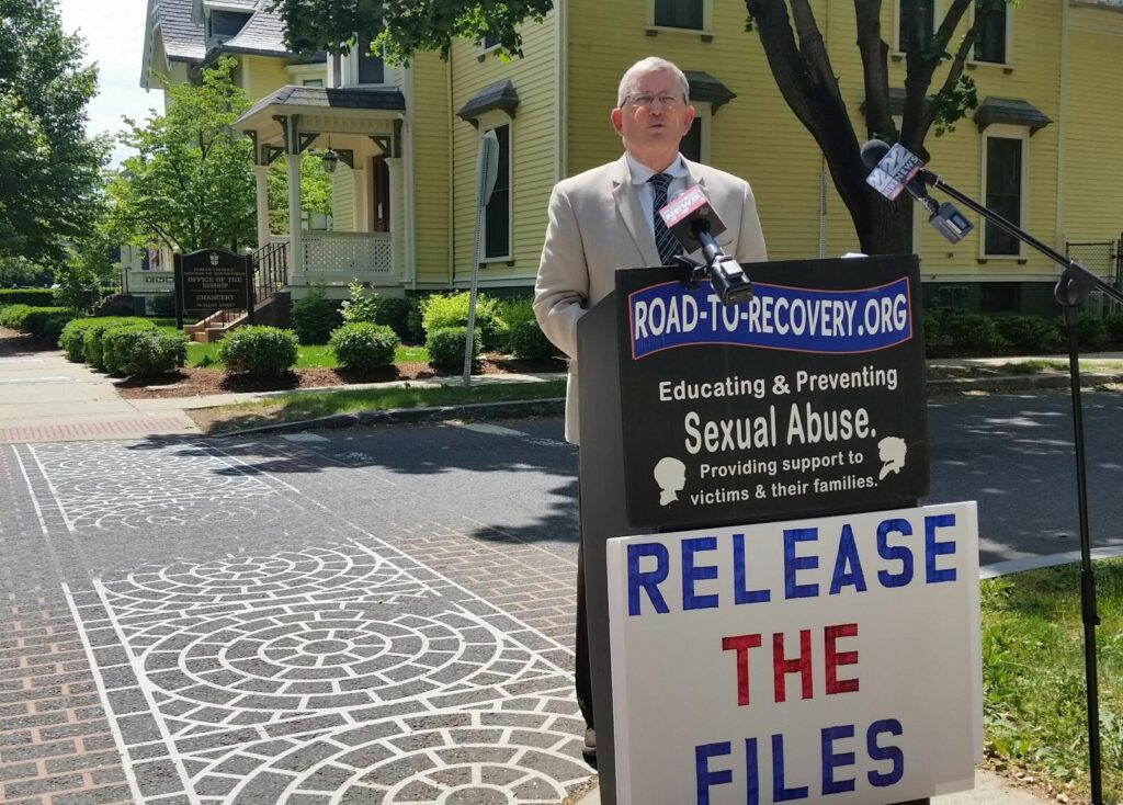 Robert Hoatson of Road to Recovery addressed reporters across the street from the chancery of the Springfield Diocese the day after the Hampden District Attorney said a recently deceased defrocked priest was the murderer of a 13-year-old altar boy in 1972. CREDIT PAUL TUTHILL / WAMC