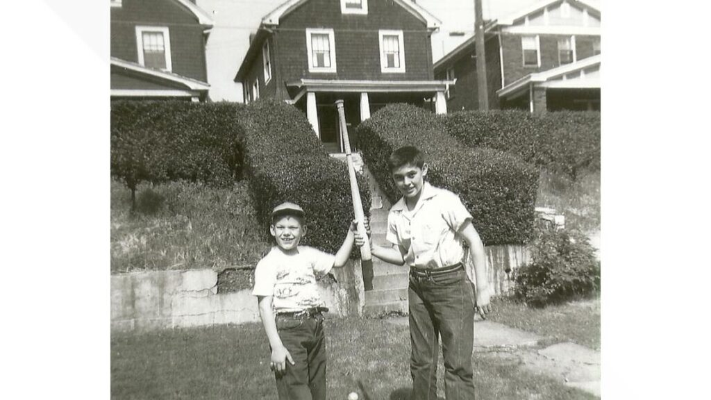 Courtesy Harriet Dudich Bobby Bizup and his cousin, Dan Pyzola, mess around with a baseball bat.