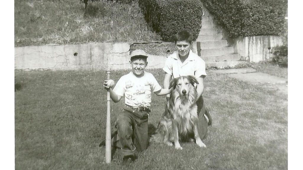 Courtesy Harriet Dudich Bobby Bizup and his cousin, Dan Pyzola, pose with Dan's dog, Duke.