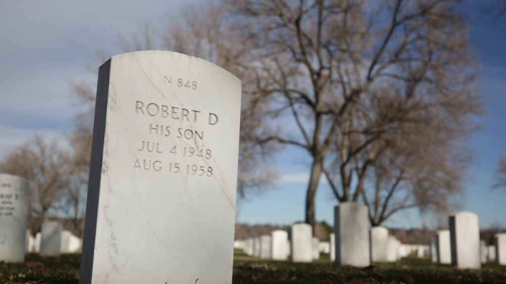 Credit: Anna Hewson, KUSA Bobby Bizup's tombstone at Fort Logan National Cemetery.