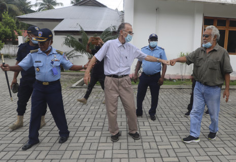 Xanana Gusmao, right, former East Timorese president and prime minister, gives a fist bump to Richard Daschbach, after a court hearing in Oecusse, East Timor, in February.CREDIT:AP