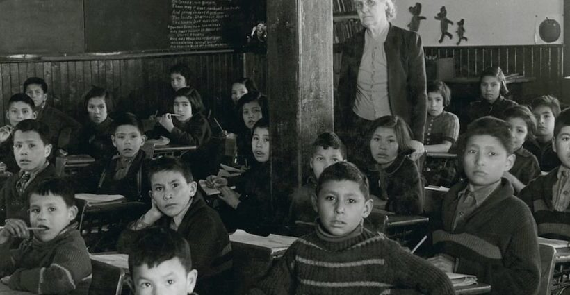 Students at their desks in in 1945 with their teacher at All Saints Indian Residential School in Lac la Ronge, Sask., where use of the Cree language was strictly forbidden. Photo: Library and Archives Canada)