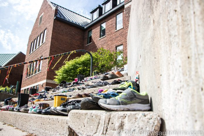 Hundreds of shoes have been placed on the steps of Shingwauk Hall, May 30, 2021 (Dan Gray / SaultOnline.com)