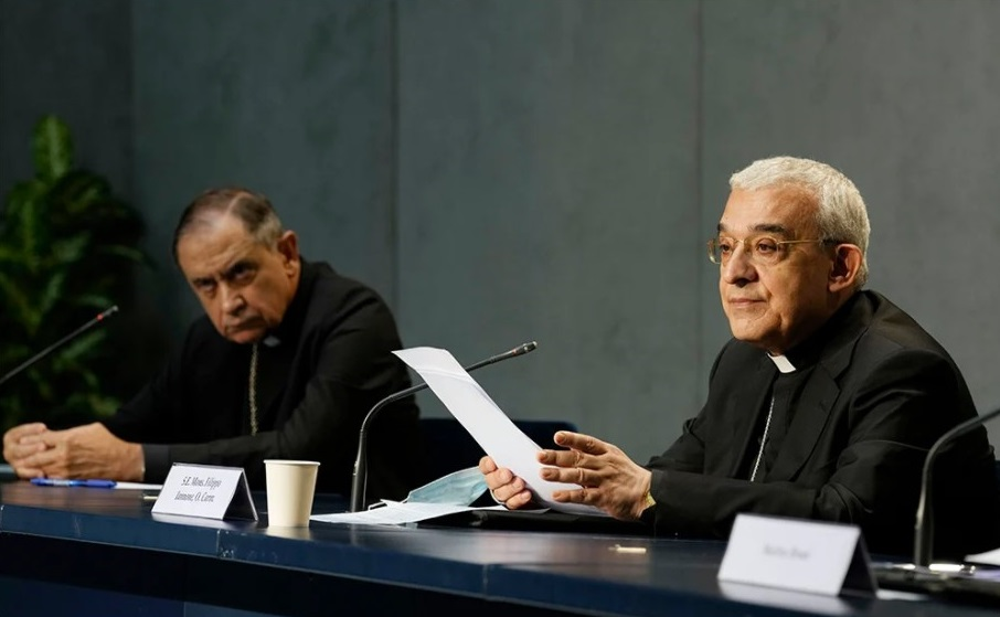 Archbishop Filippo Iannone, right, and Bishop Juan Ignacio Arrieta hold a press conference to illustrate changes in the Church's Canon law, at the Vatican, Tuesday, June 1, 2021. Pope Francis has changed church law to explicitly criminalize the sexual abuse of adults by priests who abuse their authority and to say that laypeople who hold church office can be sanctioned for similar sex crimes. (AP Photo / Andrew Medichini)