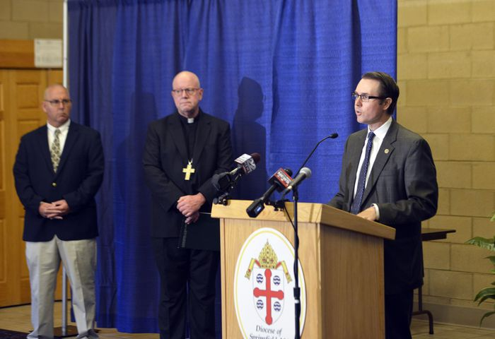 Jeffrey Trant, director of the Office of Safe Environment and Victim Assistance at the Springfield Diocese, speaks at a press conference at the Bishop Marshall Center in Springfield to discuss the addition of 40 names to the list of accused sexual abusers in the clergy. On the far left is abuse survivor Doug Cole and next him is The Most Rev. William D. Byrne, bishop of the Roman Catholic Diocese of Springfield. (Don Treeger / The Republican)