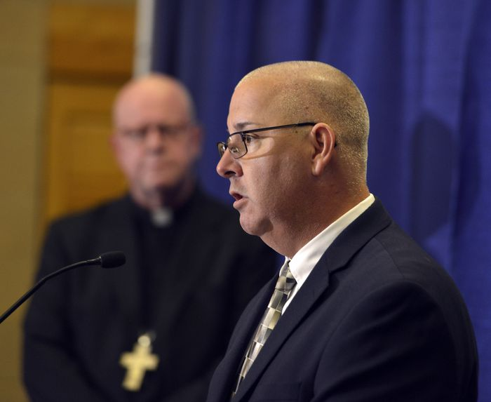 Doug Cole, a survivor of clergy abuse, speaks at a press conference at the Bishop Marshall Center in Springfield called to discuss the release of 40 names added to the list of sexual abusers, June 2, 2021. The Most Rev. William D. Byrne, bishop of the Roman Catholic Diocese of Springfield listens. (Don Treeger / The Republican)