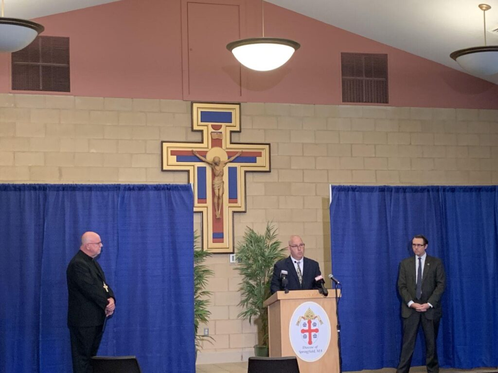 Doug Cole, center, a survivor of sexual abuse, speaks during a Wednesday news conference, flanked by Bishop William Byrne, left, and Jeffrey Trant, director of Safe Environment and Victim Assistance. Byrne and Trant announced that the Diocese of Springfield now will list 61 individuals as credibly accused of sexual abuse while associated with the diocese.  Danny Jin — The Berkshire Eagle