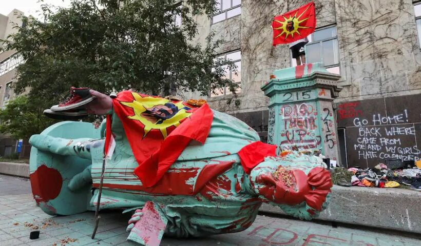 A toppled and defaced statue of Egerton Ryerson, considered an architect of Canada's residential Indigenous school system, following a protest at Ryerson University in Toronto on June 6. (Chris Helgren/Reuters)