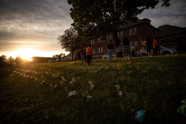 A group of youths lead a group drumming and singing at sunset outside the former Kamloops Indian Residential School, to honour the 215 children found in Kamloops on June 4, 2021.