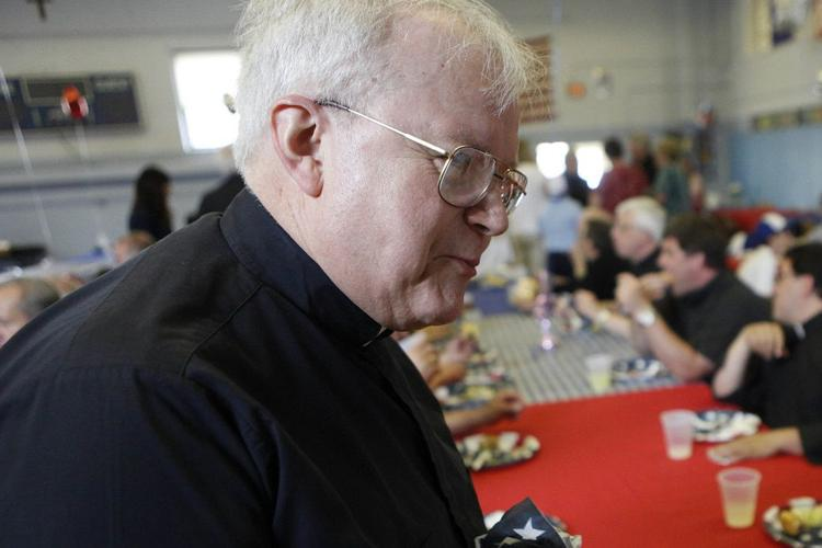 """The Rev. Louis Dolinic at a celebration of """"the year of the priest"""" in the Mary Queen of Angels Regional Catholic School cafeteria on June 3, 2010.  Derek Gee"""