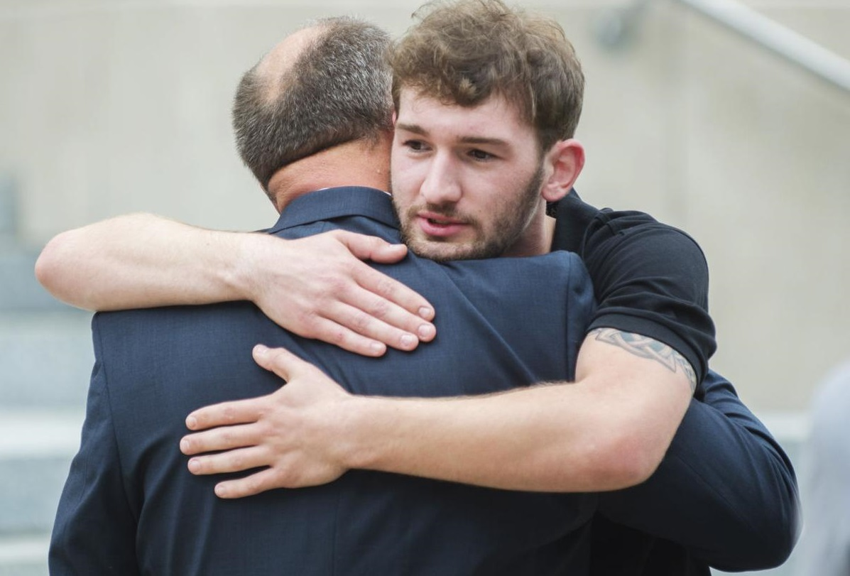 Oliver Peyton hugs his father Scott following a sentencing hearing for former priest Michael Guidry Tuesday, April 30, 2019, at the St. Landry Parish Courthouse in Opelousas, La. Advocate staff photo by Leslie Westbrook