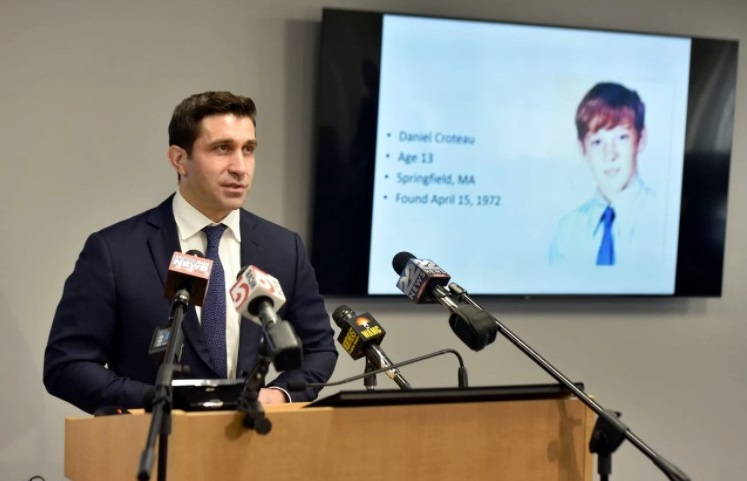 Hampden District Attorney Anthony Gulluni speaks at a press conference May 24 to say he had concluded the late former priest Richard Lavigne killed altar boy Daniel Croteau in 1972. A photo of Croteau is projected on the screen behind him. (Don Treeger / The Republican file photo)
